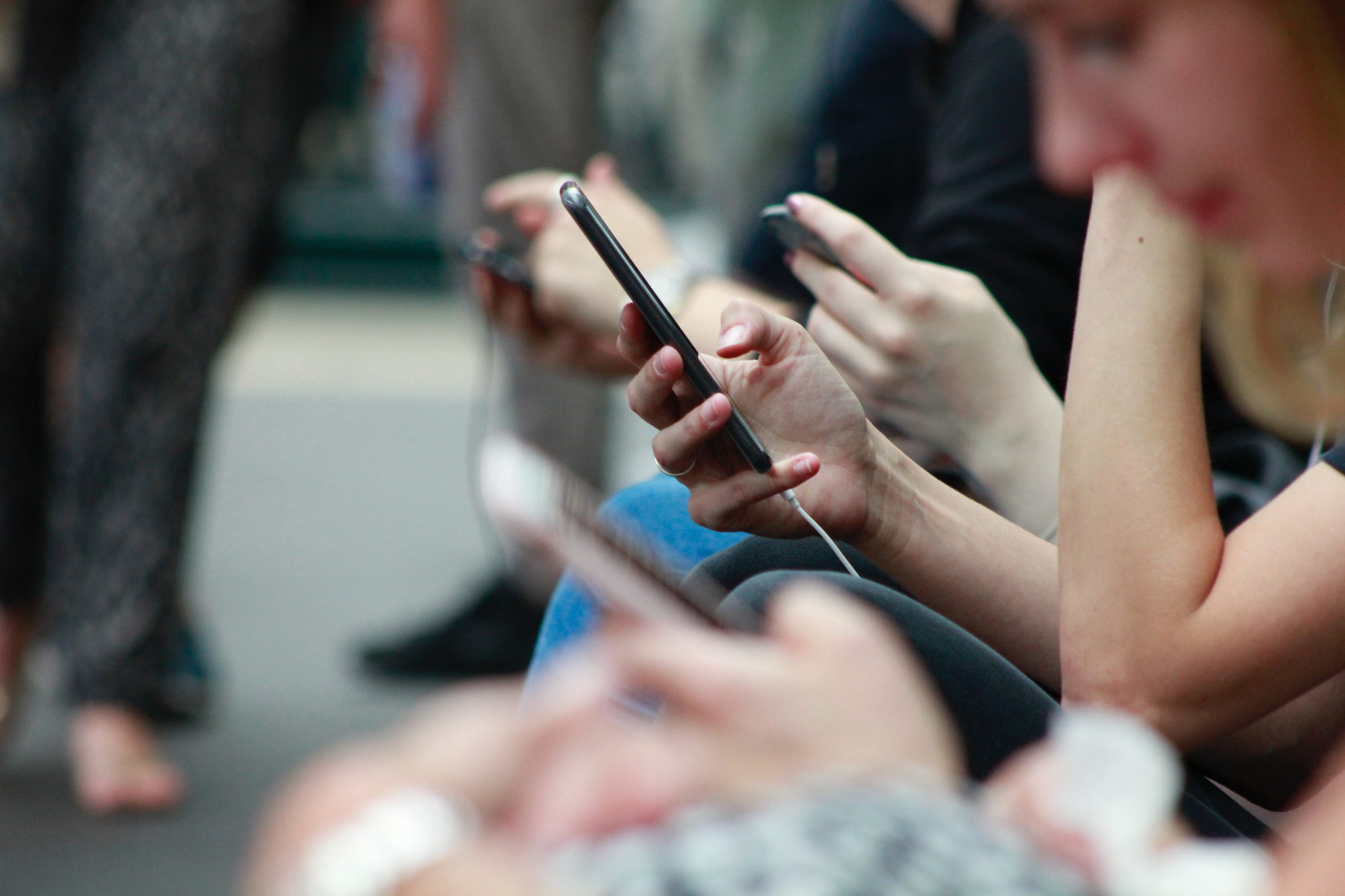 People using their mobile phones